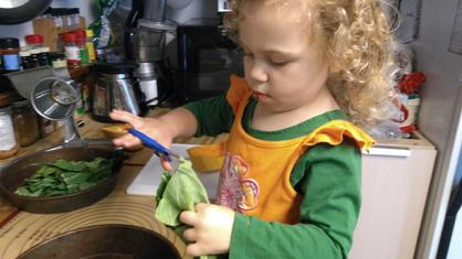 toddler helps to make salad